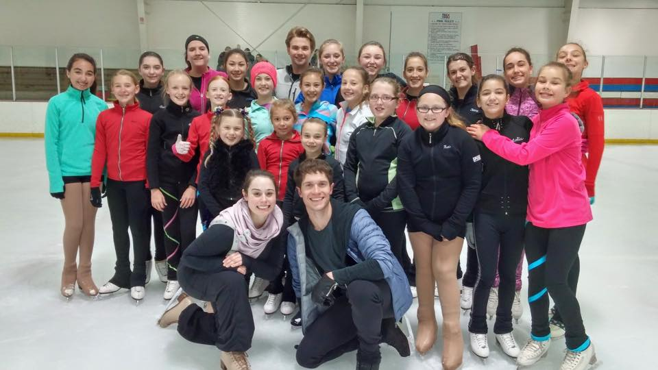 Kate McSwain & Drew Meekins with kids attending skating seminar in Tampa Bay