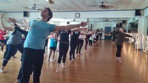 Kate McSwain leading a dance exercise to build core body awareness